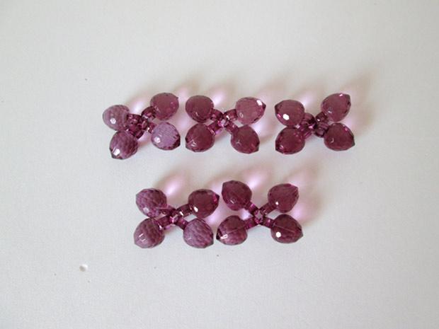 Cacho de uva em pedraria