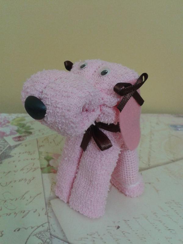 Cachorro em toalha